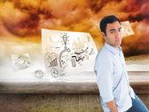 Samengestelde afbeelding van kijkende casual man permanent — Stockfoto