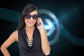 Composite image of happy brunette phoning — Stock Photo