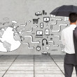 Stock Photo: Composite image of businessmstanding back to camerholding umbrella