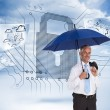 Happy businessman holding umbrella — Stock Photo