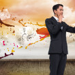 Composite image of thoughtful asian businessman pointing — Foto Stock