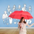 Composite image of attractive businesswoman holding red umbrella — Stock Photo