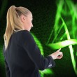 Stock Photo: Composite image of businesswompointing somewhere