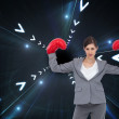 Composite image of businesswoman with boxing gloves — Stock Photo