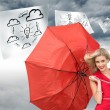 Composite image of smiling blonde holding umbrella — Stock Photo