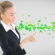 Composite image of businesswoman pointing somewhere — Stock Photo