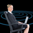 Composite image of businesswoman sitting on swivel chair with laptop — Stock Photo #38527937