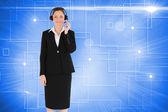Good looking woman in suit using headphones — Stockfoto