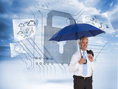Happy businessman holding umbrella — Stock Photo