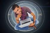 Thoughtful man sitting on floor using laptop — Stock Photo