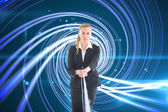 Composite image of businesswoman pulling a rope — Stock Photo