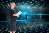 Blonde businesswoman holding new tablet — Stockfoto