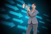 Composite image of businesswoman with loudspeaker — Stockfoto