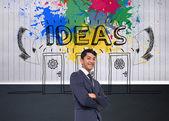 Imagen compuesta del empresario informal sonriente con los brazos cruzados — Foto de Stock