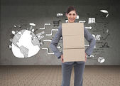 Businesswoman carrying cardboard boxes — Stock Photo