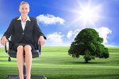Composite image of businesswoman sitting on swivel chair — Stock Photo