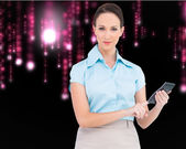Serious classy businesswoman using calculator — Stok fotoğraf