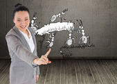 Smiling asian businesswoman pointing — Stock Photo