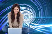 Woman smiling with laptop — Stock Photo