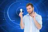 Model holding a bulb in right hand — Stock Photo