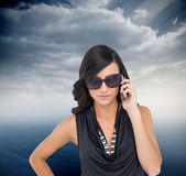 Brunette wearing sunglasses on the phone — Stock Photo