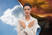 Composite image of charismatic businesswoman with her arms crossed — Stock Photo