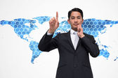 Composite image of thoughtful asian businessman pointing — Stock Photo