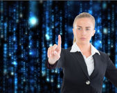 Composite image of businesswoman pointing somewhere — Стоковое фото
