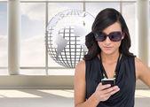 Happy brunette using smartphone — Stock Photo