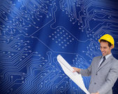 Architect with hard hat looking at plans — Stock Photo