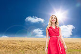 Composite image of smiling blonde walking — Stock Photo