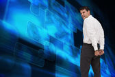 Composite image of rear view of young businessman wearing handcuffs — Stock Photo