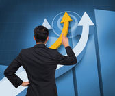 Composite image of asian businessman pointing — Stock Photo