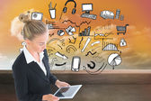 Composite image of businesswoman holding new tablet — Stockfoto