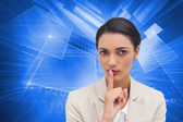 Composite image of young businesswoman asking for silence — Stock Photo