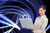 Confident businesswoman holding laptop — Stock Photo
