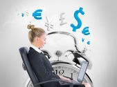 Composite image of businesswoman sitting on swivel chair with laptop — Stock Photo