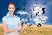 Serious classy businesswoman using calculator — Stock Photo