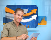 Happy man using tablet pc — Stock Photo
