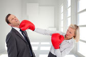 Businesswoman hitting colleague — Stock Photo
