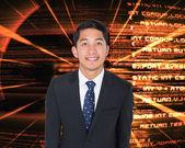 Kompozitní obraz usmívající se asijský obchodník — Stock fotografie