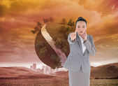 Thoughtful asian businesswoman pointing — Stock Photo