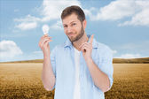 Charming model holding a bulb in right hand — Stock Photo