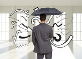 Composite image of rear view of classy businessman holding grey umbrella — Stock Photo