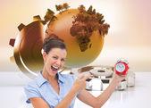 Composite image of businesswoman indicating alarm clock — Stock Photo