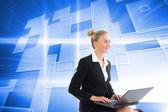 Blonde businesswoman using laptop — Stock Photo