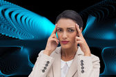 Composite image of young businesswoman putting her fingers on her temples — Stock Photo