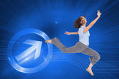 Classy businesswoman jumping while holding smartphone — Stock Photo
