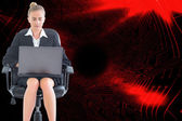 Composite image of businesswoman sitting on swivel chair with laptop — Stok fotoğraf