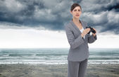Businesswoman posing with binoculars — Stock Photo